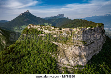 Aerial view of Saint Eynard fortifications and Chartreuse mountain range near Grenoble (France) - Stock Photo