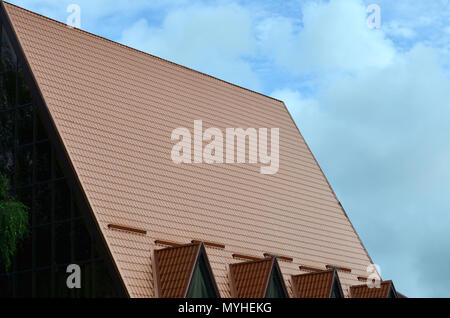 The house is equipped with high-quality roofing of metal tiles. A good example of perfect modern roofing. The building is reliably protected from adve - Stock Photo