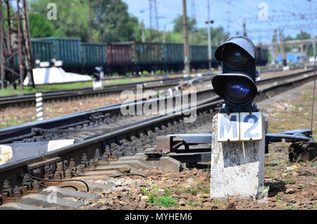 Railway traffic light (semaphore) against the background of a day railway landscape. Signal device on the railway track - Stock Photo