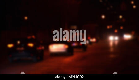 Nights lights of the big city, the blurred night avenue with bokeh traffic lights and headlights of the approaching cars - Stock Photo