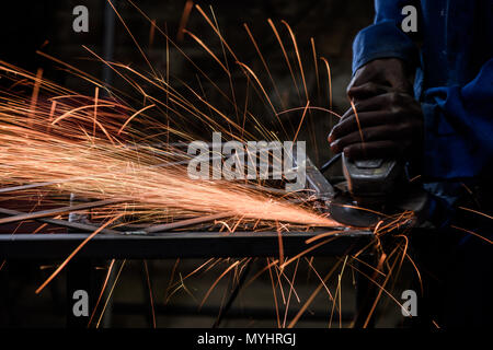 A metal worker on an Eastern Cape farm in South Africa. Farmers often establish small businesses to help pay for the costs of farming - Stock Photo