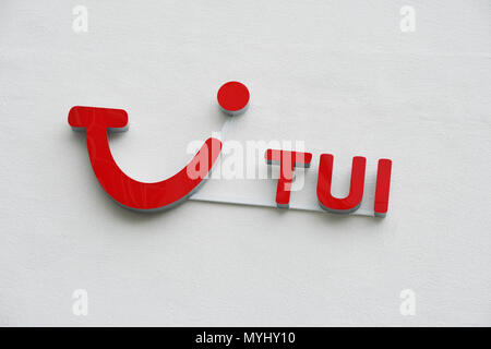 Hannover, Germany - June 6, 2018: TUI logo and brand sign on wall. TUI Group is the largest travel and tourism company in the world, headquartered in Hannover. - Stock Photo