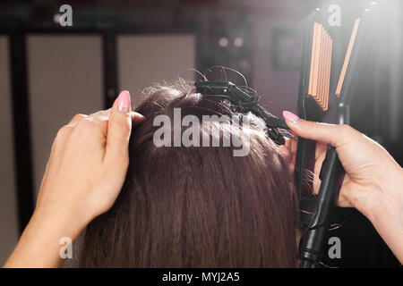 hairdresser clipping hair of a model - Stock Photo