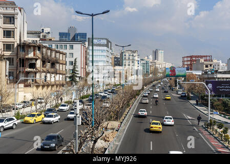 Tehran, Iran - March 18, 2018: View of the street, traffic on the road in center of city - Stock Photo