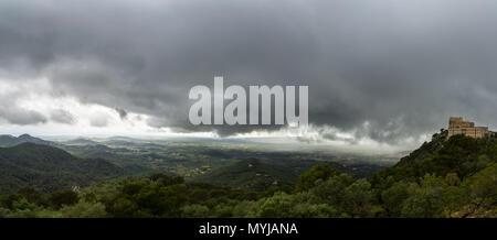 Mallorca, Ancient cloister of Sant Salvador on top of green mountain XXL panorama - Stock Photo