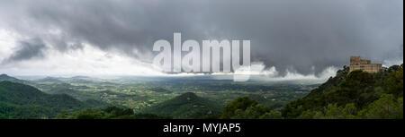 Mallorca, Monastery Sant Salvador with dark clouds on top of mountain XXL panorama - Stock Photo