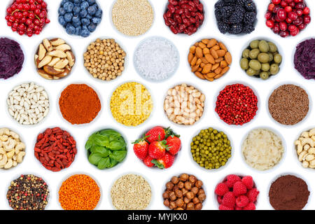 Collection of fruits berries vegetables nuts background from above isolated on a white background - Stock Photo