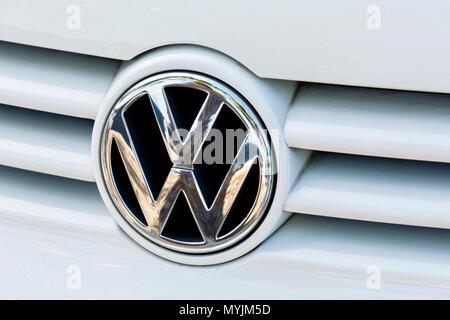 Germany, Berlin - May 14, 2018: Logo of the German car company Volkswagen on the radiator grille - Stock Photo