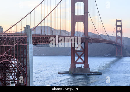 Sunset over the Golden Gate Bridge as seen from the span's southern end. - Stock Photo