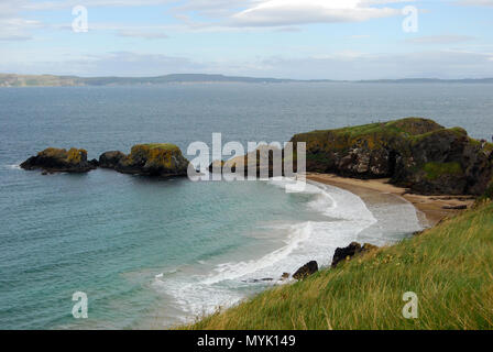 Near Carrick-a-Rede rope bridge is Larrybane beach, a coastal beauty featured in Game of Thrones - Stock Photo