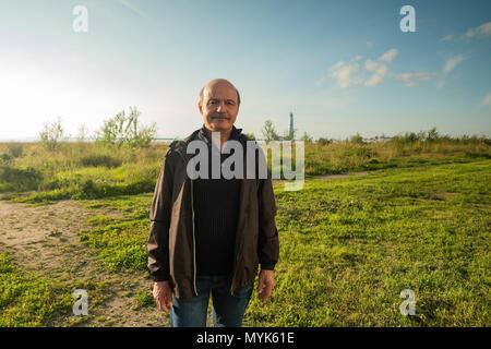 Portrait of a senior man outdoors - Stock Photo