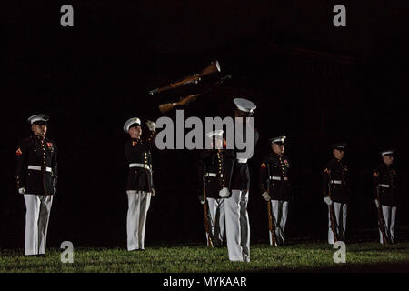 The U.S. Marine Corps Silent Drill Platoon performs during an evening parade at Marine Barracks Washington, Washington, D.C., May 05, 2017. Evening parades are held as a means of honoring senior officials, distinguished citizens and supporters of the Marine Corps. - Stock Photo