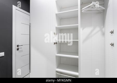 Interior of modern empty wardrobe room. Hotel modern standart room. simple and stylish interior. interior lighting