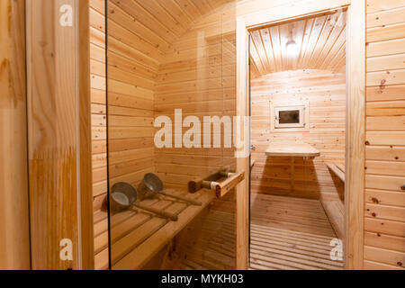 interior of sauna. rural mobile wooden bath in the form of a barrel in a pine forest - Stock Photo