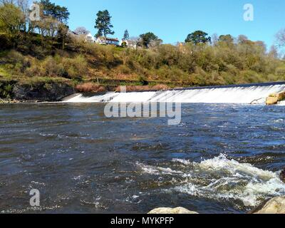 walk along cardiff weir on a beautiful summers day watching the cool water cascade down into the river - Stock Photo