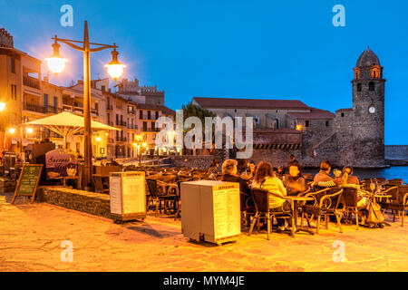 Outdoor cafe on the beach, Collioure, Pyrenees-Orientales, France - Stock Photo