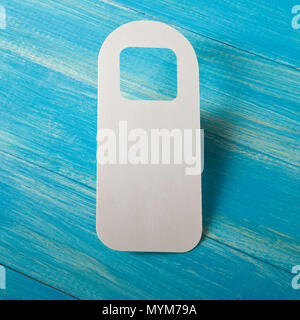 White door hanger on a blue wooden planks - Stock Photo