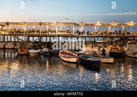 Evening view of the Ristorante Bagni Delfino in the Marina Grande, Sorrento, The Amalfi Coast, Campania, Italy, Europe - Stock Photo