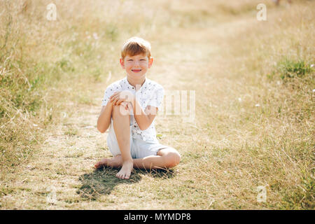 Fashionable boy in the field - Stock Photo