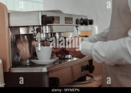 Close up of male hands that using coffee-engine - Stock Photo