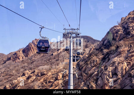 BADALING, CHINA - MARCH  13, 2016: Great Wall of China. A cable car taking visitors up to the Great Wall of China. - Stock Photo