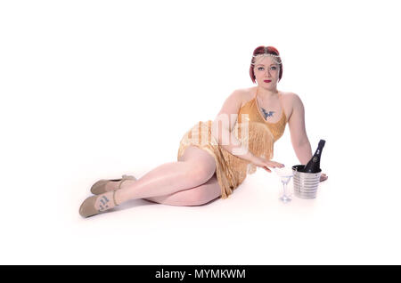 1920s flapper girl drinking alcohol - Stock Photo