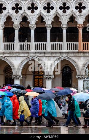Tourists In St Mark's Square In The Rain, Venice, Italy - Stock Photo