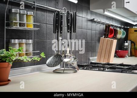 Kitchen utensils on work top in modern kitchen closeup - Stock Photo