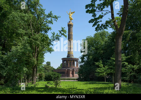a view of the popular Victory Column in Berlin, Germany, seen from the Tiergarten park - Stock Photo