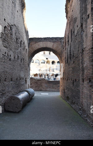 View from an entrance into the Colosseum (Coliseum) or Flavian Amphiteatre in the centre of Rome, Italy. - Stock Photo