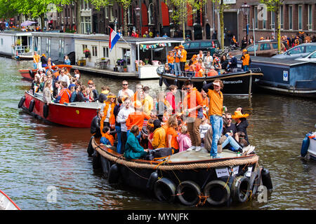 People on the boat celebrate King's day in Amsterdam city, Netherlands - Stock Photo