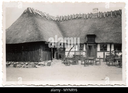 A traditional old wooden and thatched farmhouse near Odense on the island of Funen, Denmark.  Photograph made circa 1946 - Stock Photo