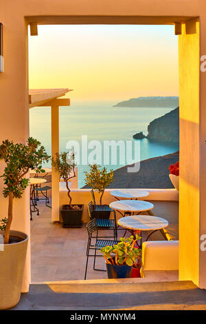 View of seashore through open door in Santorini Island, Greece - Stock Photo