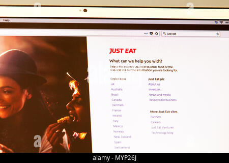 Just Eat, Just Eat UK, Just Eat plc is an online food order and delivery service, Just Eat app, Just Eat app uk, Just Eat order food, online order - Stock Photo
