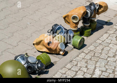 Gas masks of second world war displayed on street for tourists as souvenir - Stock Photo