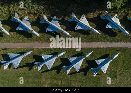 Aerial drone view on military airbase with old Russian jet fighters. Airplanes cemetery - Stock Photo