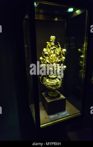 Vienna, Austria - October 22, 2017: Golden rose in the Imperial Treasury or Kaiserliche Schatzkammer at the Hofburg Palace - Stock Photo