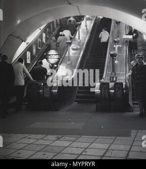 1960s, historical, people going up the escalators on the London Underground, London, England, UK. - Stock Photo