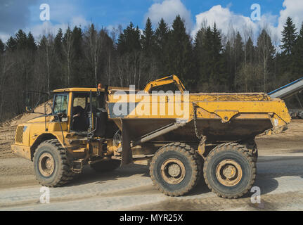 Sand tipper truck on construction site. - Stock Photo