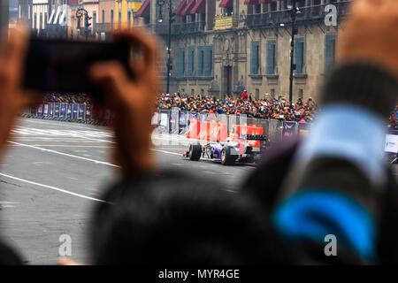 Mexico City, Mexico - June 27, 2015: Daniel Ricciardo driving around the Mexico City Zocalo Square at the Infiniti Red Bull Racing F1 Showrun. - Stock Photo
