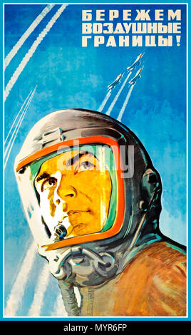 "Vintage 1960's Soviet propaganda flight exploration poster: ""We Guard The Air Borders!"" Featuring illustration of USSR air force pilot wearing a high altitude oxygen helmet and looking up towards military planes leaving white trails in the blue sky as they fly upwards at speed - Stock Photo"