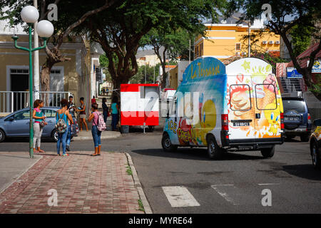 Ice Cream truck and people in the streets. Life in MINDELO, CAPE VERDE - DECEMBER 07, 2015
