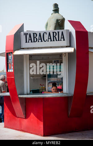 Tabacaria - tobacco shop hut selling drinks. Woman in the window thinking and dreaming MINDELO, CAPE VERDE - DECEMBER 07, 2015