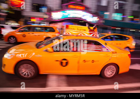 New York yellow taxi cabs in Times Square at night, Times Square, New York city USA - Stock Photo