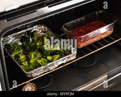 prepared meals dream dinners meatloaf milano with oven roasted broccoli in oven - Stock Photo
