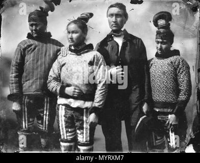 .  English: An Inuit group in Inuit and European clothes. An Inuit man dressed in European clothes with three Inuit women in traditional clothing. The upper garment of the woman on the right may be knitted wool (like the ones worn by the Danish official and his sons in G4263) and may represent a fusion between Inuit and Nordic clothing. The Inglefield Album held by the Royal Archives records noted that the people in the photograph are (l-r) Mother, Daughter, Fiance, and Sister-in-Law. An Inuit group in Inuit and Eurpoean clothes.  . 8-17 June 1854. Captain Edward Augustus Inglefield 351 An Inu