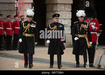 Horse Guards, London, UK. 7 June, 2018. More than 750 soldiers wow an audience of 6,000 spectators with a heart stopping display of military music, horsemanship, precision drill, pageantry, and fireworks in the annual celebration that is the Household Division's Beating Retreat. 'Alliance of the Free' in the presence of the HRH Prince Andrew, Duke of York, who arrives with Major General Ben Bathurst CBE (left) and Colonel Crispin Lockhart, Chief of Staff London District, British Army (right). Credit: Malcolm Park/Alamy Live News. - Stock Photo