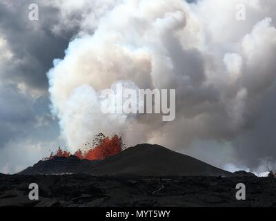 Hawaii, USA. 6th June, 2018. A massive lava fountain spewing magma 150 feet into the air from fissure 8 at the corner of Nohea and Leilani caused by the eruption of the Kilauea volcano June 6, 2018 in Hawaii. The recent eruption continues destroying homes, forcing evacuations and spewing lava and poison gas on the Big Island of Hawaii. Credit: Planetpix/Alamy Live News - Stock Photo