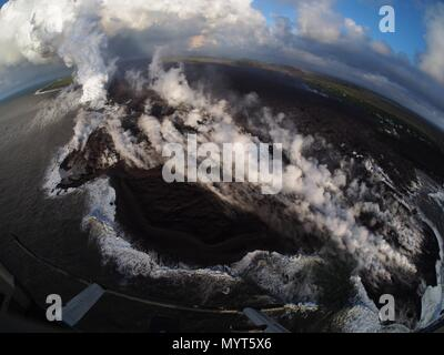 Hawaii, USA. 6th June, 2018. Lava flows into Kapoho Bay destroying forest and homes in the Vacationland area caused by the eruption of the Kilauea volcano June 6, 2018 in Hawaii. The recent eruption continues destroying homes, forcing evacuations and spewing lava and poison gas on the Big Island of Hawaii. Credit: Planetpix/Alamy Live News - Stock Photo