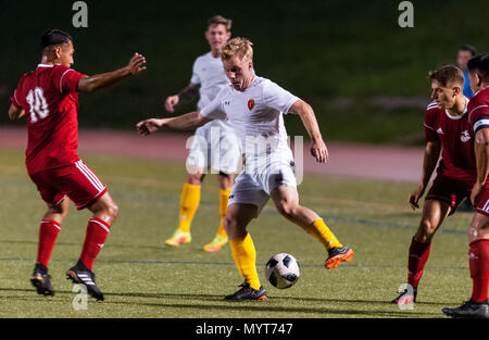 Fort Bragg, North Carolina, USA. 7th June, 2018. June 7, 2018 - Fort Bragg, N.C., USA - All-Army Soccer 1st Lt. Alexander Clark (10) works his way past All-Marine Corps Soccer Staff Sgt. Giovanny Calderon (10) during a third round match between the U.S. Army and the United States Marine Corps at the 2018 Armed Forces Men's Soccer Championship, at Hedrick Stadium, on Fort Bragg. Army defeated the Marines, 2-1. The Armed Forces Men's Soccer Championship is conducted every two years. Credit: Timothy L. Hale/ZUMA Wire/Alamy Live News - Stock Photo